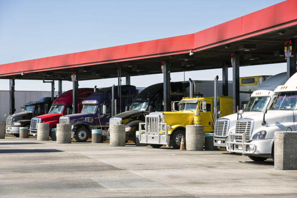 Semi truck fleet fuel efficiency at gas station