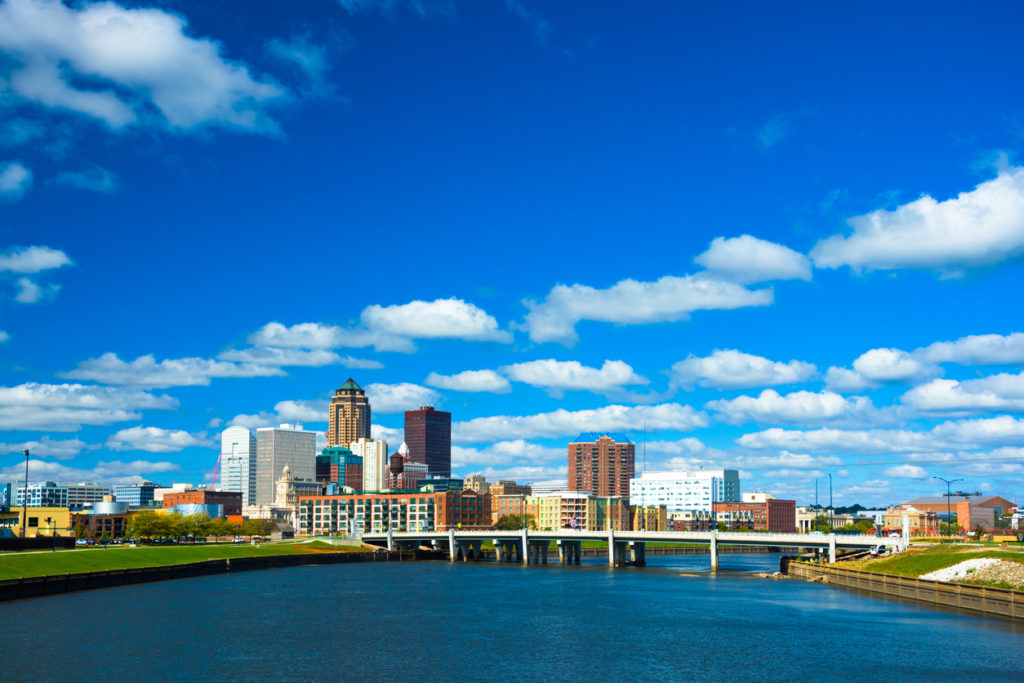 Des Moines skyline with puffy clouds and river